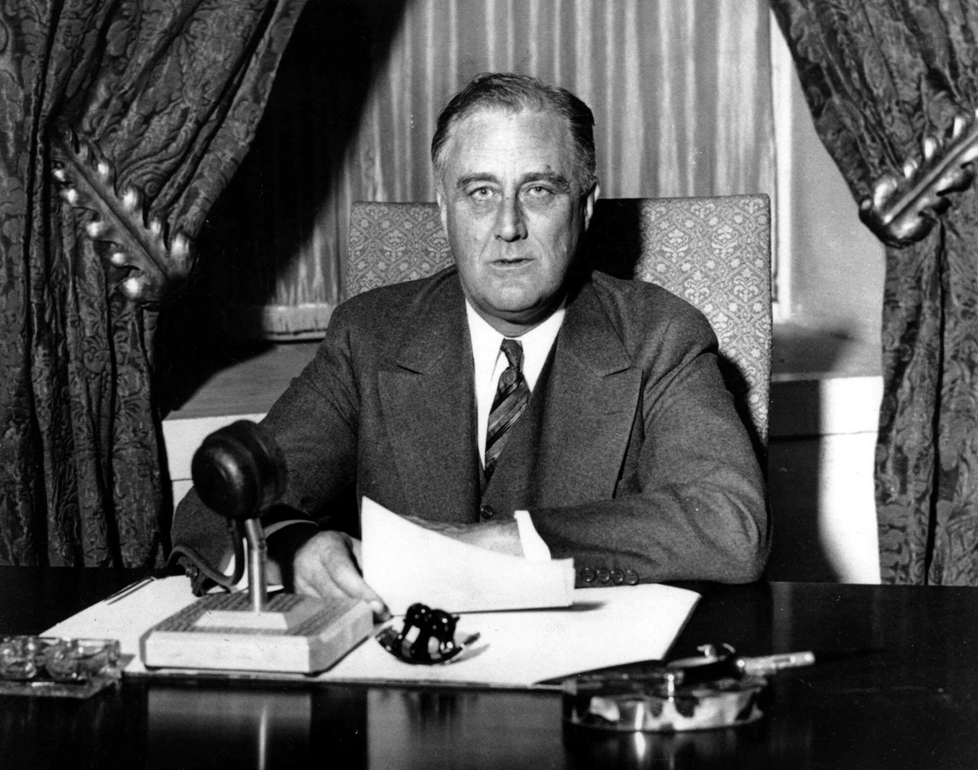 FILE -- President Franklin D. Roosevelt prepares to begin his first fireside chat to the American people in this March 12, 1933 file photo. Speaking to the nation on radio from the White House in Washington, Roosevelt explained in simple langauge the measures he was taking to solidify the nation's shaky banking system. Roosevelt had been in office less than 100 days. (AP Photo/File) ORG XMIT: WX30